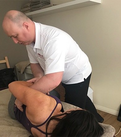 Revive-Igor-Mirkin-Holistic-Chiropractor-working-on-client-hip