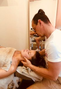 Igor Mirkin applying Soft Tissue Treatment to a client's left arm
